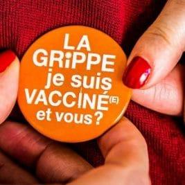 Photo d'un badge portant la mention : la grippe, je suis vacciné(e) et vous ?