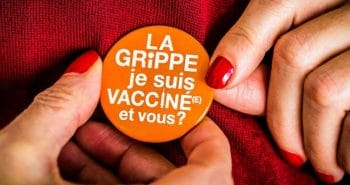 Photo d'un badge portant la mention : la grippe, je suis vacciné(e) et vous ?
